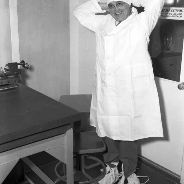 Dr. Draper Putting On Clean Room Suit