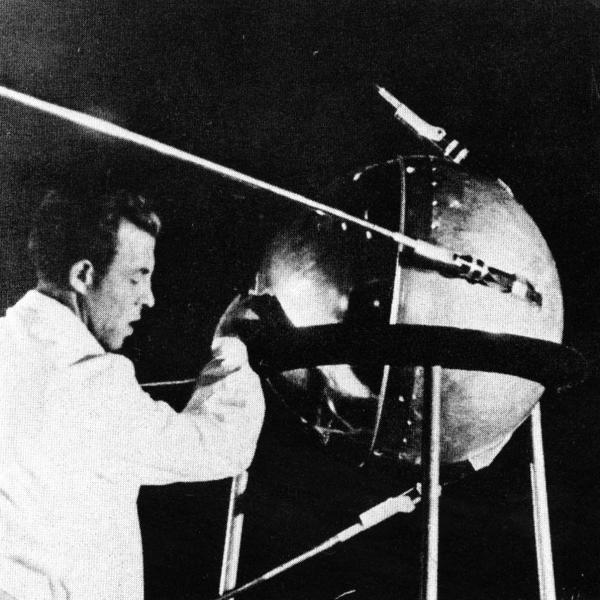 Engineer with Sputnik 1 Satellite