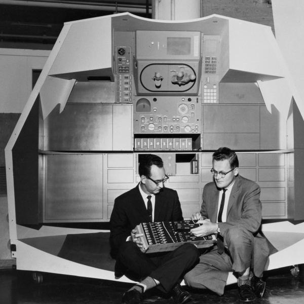 Ragan & Hall Seated In Front Of A Mock-up Of Apollo Controls