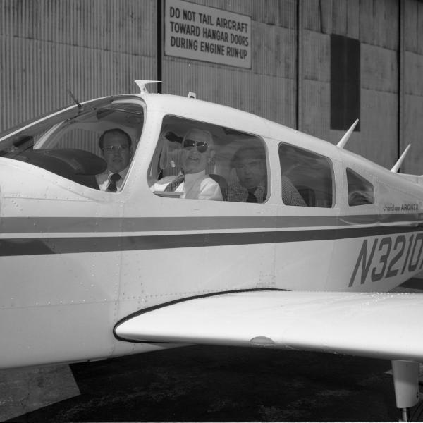Chip Collins and Doc Draper In An Airplane At Bedford Flight Facility
